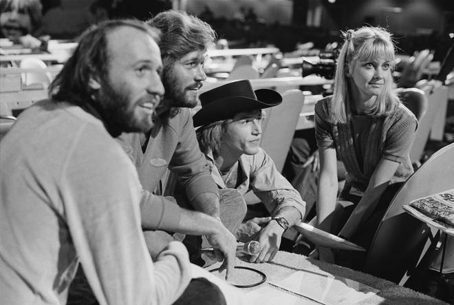 Maurice, Barry and Andy Gibb pictured in rehearsals with Olivia Newton-John at the 1979 UNICEF event.