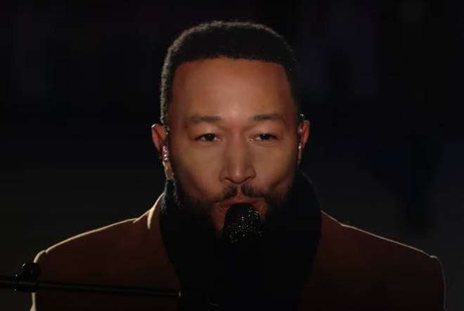 Wrapped up warm against the Washington D.C. chill, John Legend then made his way to sit at the piano and continued to sing while accompanied by of a large jazz band.