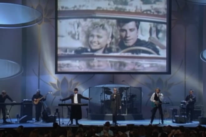 As iconic scenes from the movie Grease were beamed across a large screen, with especially recorded vocals from Frankie Valli playing as the Bee Gees sang the song directly to Olivia.