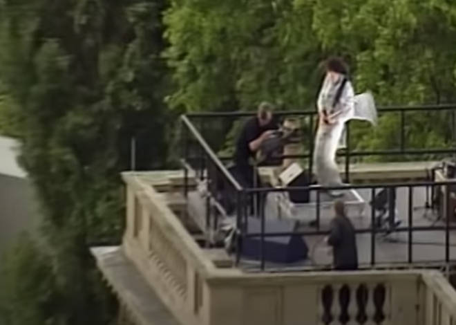 Brian May made his way all the way up through Buckingham Palace, out onto its roof and high among the battlements, for an extraordinary performance of 'God Save The Queen'.