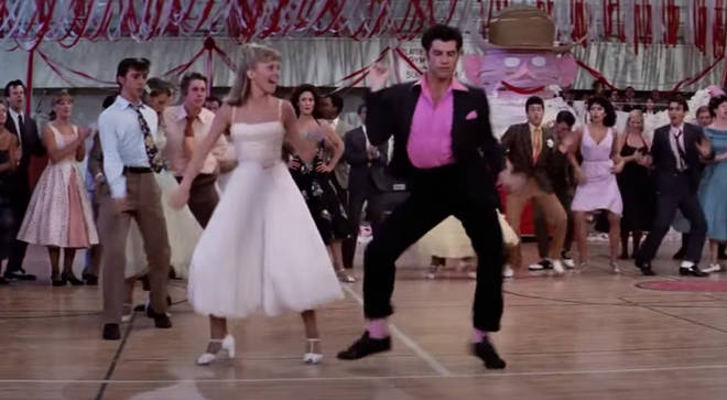 The 66-year-old actor stepped back into the dancing shoes of his T-Birds character Danny Zuko to reenact that famous 'Born to Hand Jive' routine from the 1978 hit film.