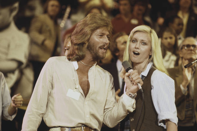 Barry Gibb performs with Olivia Newton-John at 'The Music for UNICEF Concert: A Gift of Song' benefit concert held at the United Nations General Assembly in New York City on 9th January 1979.