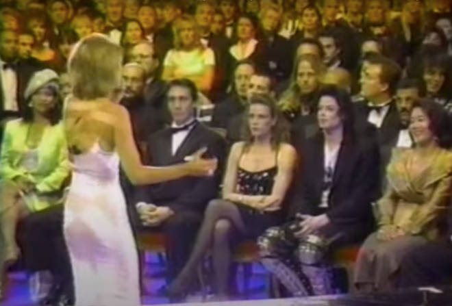 The video sees Michael Jackson look on from the front row of the audience.