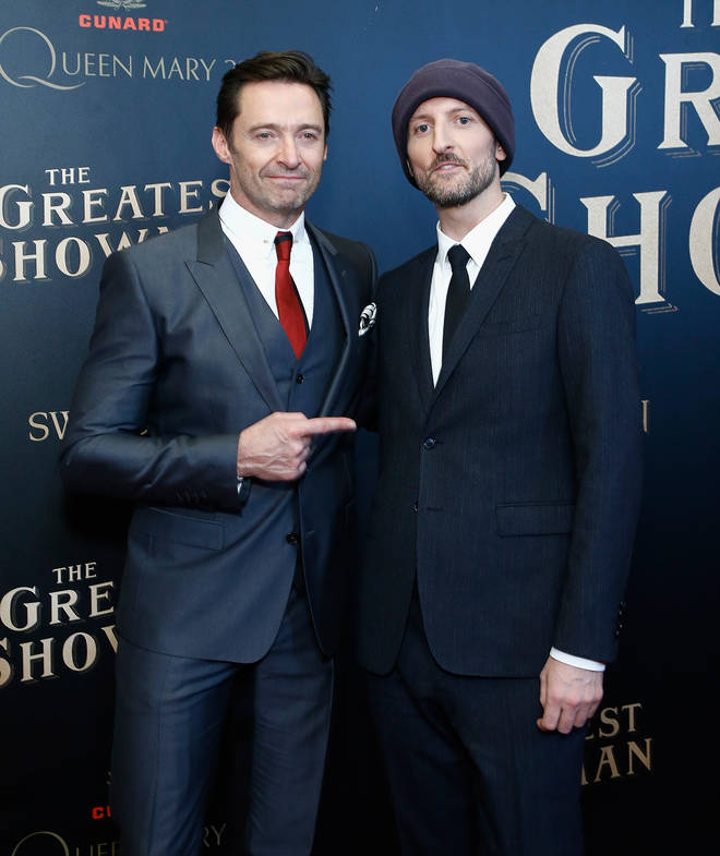 Michael Gracey (pictured right with Hugh Jackman) said he has spent hours talking to the singer about his life and wants to tackle the biopic in a way that hasn't been seen before.