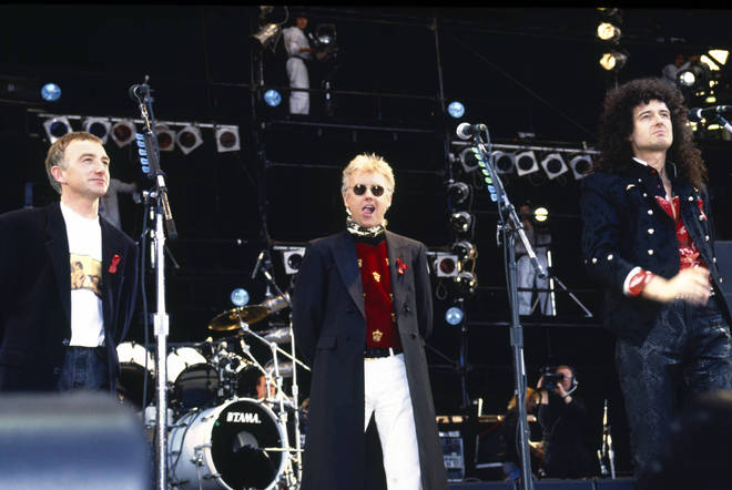 Queen's John Deacon, Roger Taylor and Brian May on stage at the Freddie Mercury tribute concert