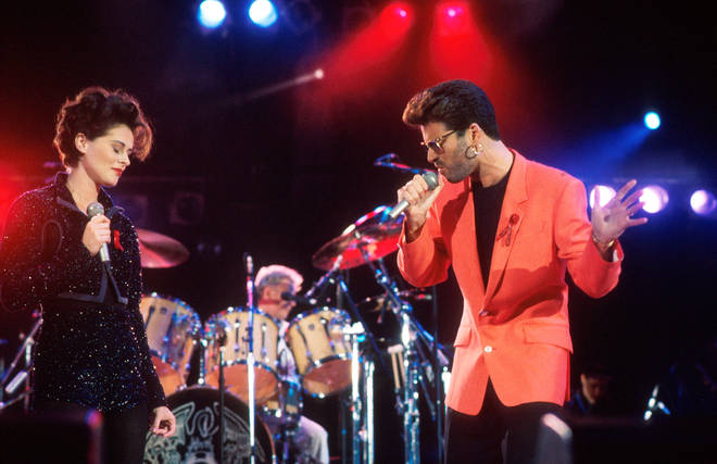 Lisa Stansfield and George Michael perform on stage with Roger Taylor of Queen at the Freddie Mercury Tribute Concert, Wembley Stadium, London, 20th April 1992.
