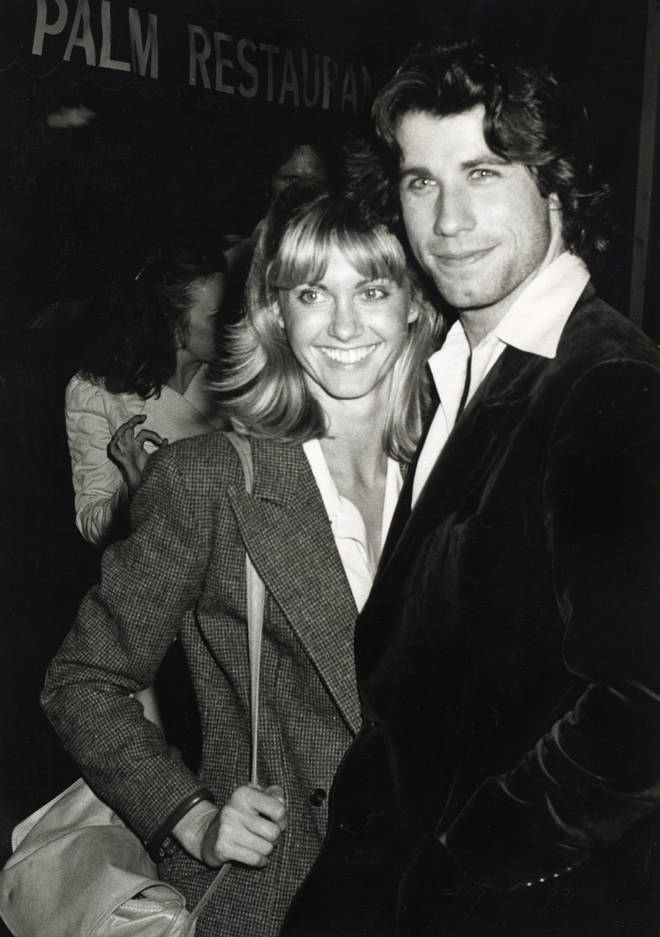 John Travolta and Olivia Newton-John pictured at dinner at the Palm Restaurant in Beverly Hills in April 1978