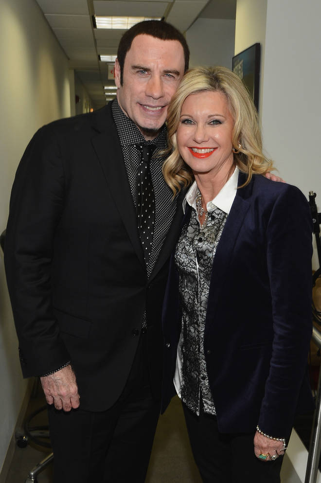 John Travolta and Olivia Newton-John pictured in New York on December 12, 2012
