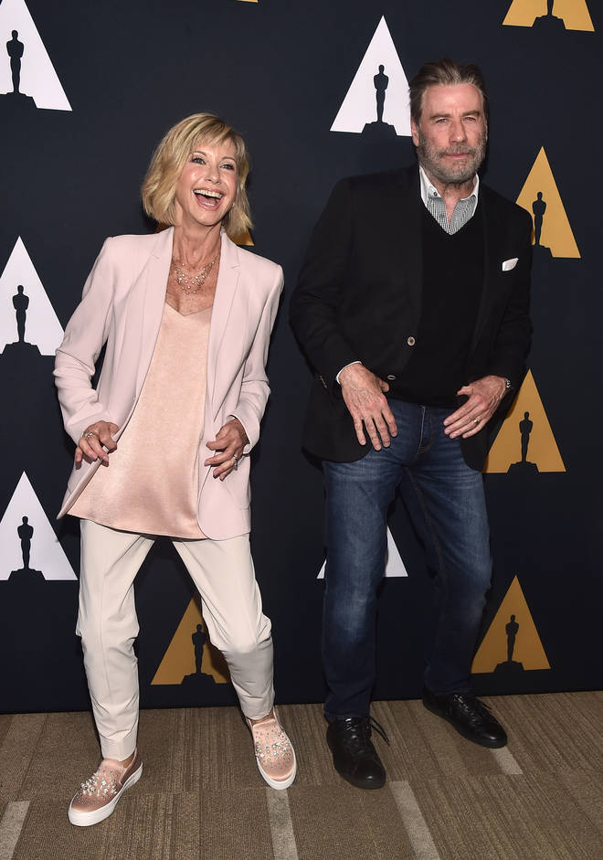 Olivia Newton-John and John Travolta attend a 'Grease' 40th Anniversary party at the Samuel Goldwyn Theater on August 15, 2018 in Beverly Hills