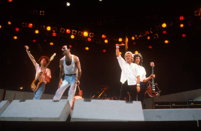 Queen at Live Aid on July 13, 1985. The band's 17-minute set has become one of the famous moments in music history.