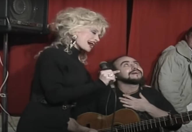As the star performs the heartfelt song, she turns and sings a few lines with the guitarist Steve, who is overwhelmed by the moment and places a hand on his heart and looks up to the sky in thanks.