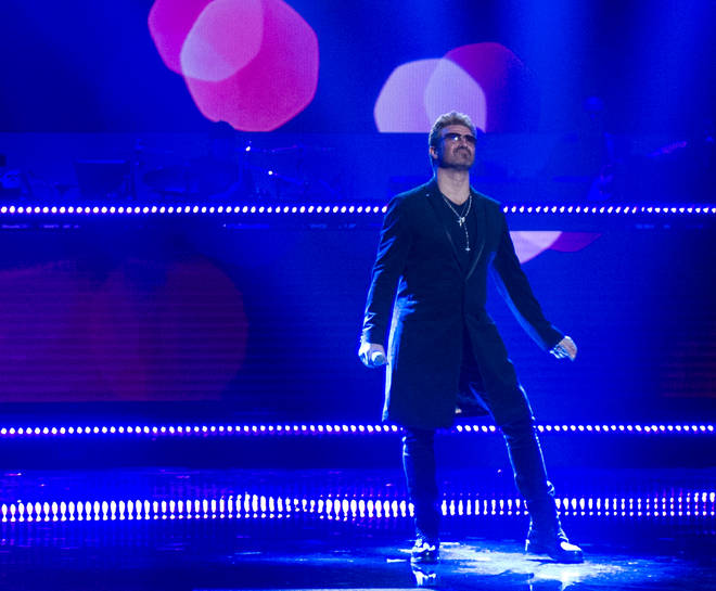 Rob Lamberti performs on stage as George Michael