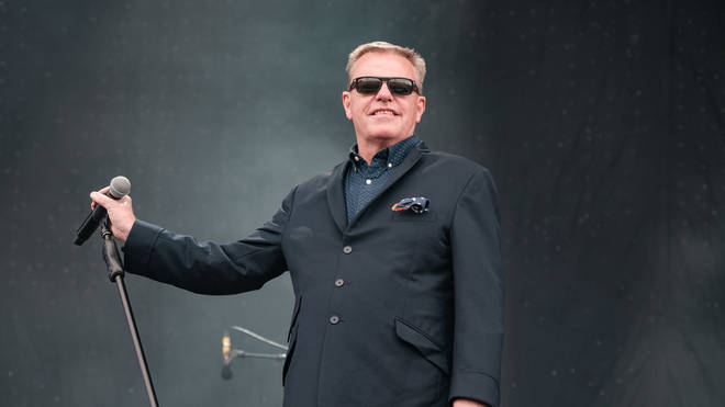 Suggs performing at the Isle of Wight Festival 2019