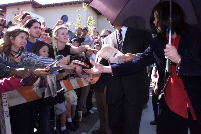 Prince said he didn't realise how famous his father was growing up. Pictured, Michael Jackson signs autographs for fans in 2002.