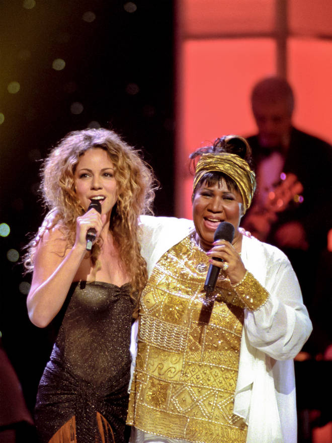 Mariah Carey (left) and Aretha Franklin perform onstage during the 'Divas Live--An Honors Concert for VH1 Save the Music' at the Beacon Theater, New York, New York, April 14, 1998.