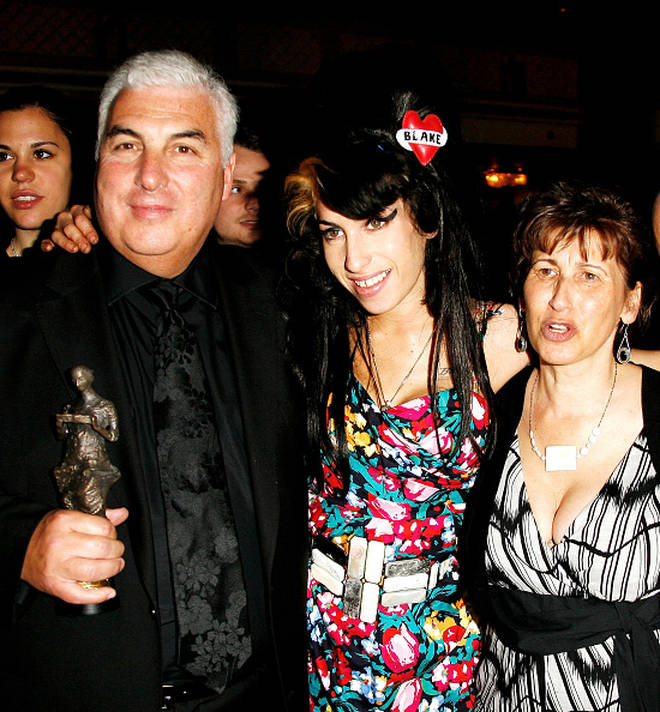 Amy pictured with her parents, who split in 1993