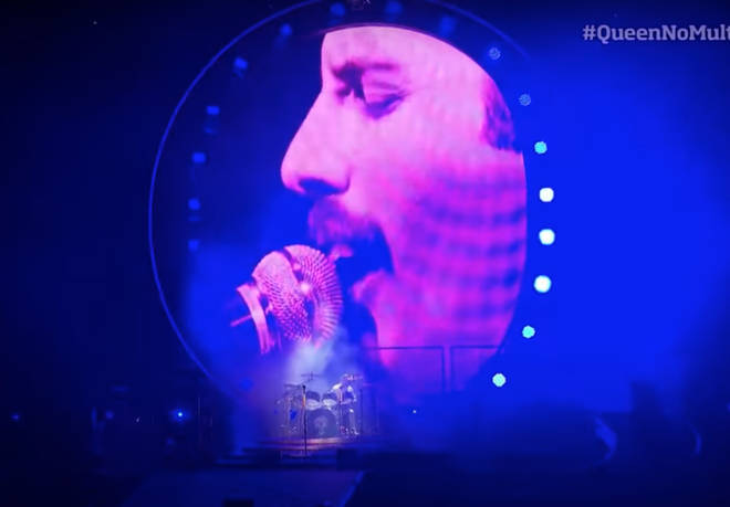 A screen then lit up the stage behind Adam Lambert showing footage of Freddie Mercury singing and playing the piano.