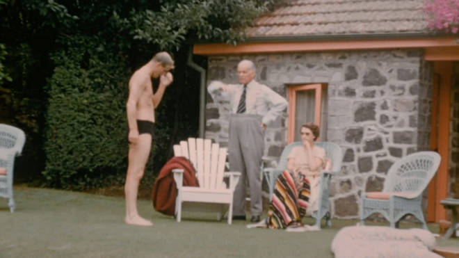 The Queen and Prince Philip talk by the pool at the home of at the home of New Zealand's Governor-General, Sir Willoughby Norrie