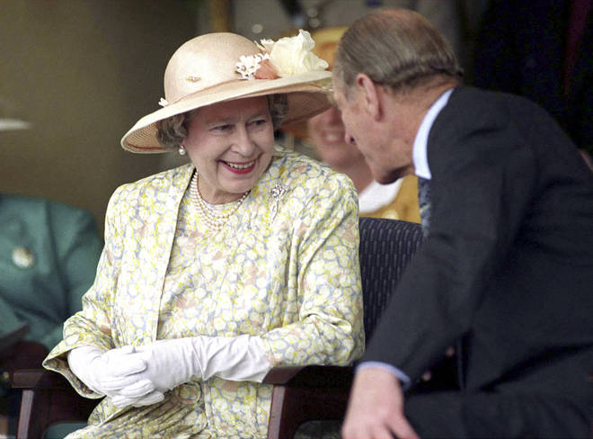The Queen and Prince Philip chat during a visit to Vukuzakhe High School in Durban, South Africa on March 23, 1995.