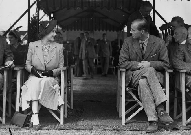 Newlyweds Princess Elizabeth and the Duke of Edinburgh share a laugh at the Royal Horse Show at Windsor, 12th May 1949.