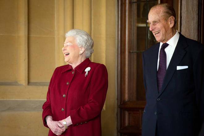 Queen Elizabeth II and Prince Philip share a laugh at Windsor Castle in April 2014.