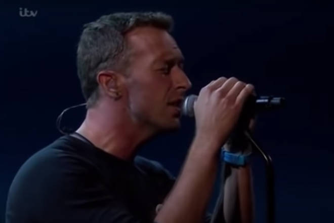 """Chris Martin was introduced to the stage as of """"the finest singer-songwriters of his generation."""""""