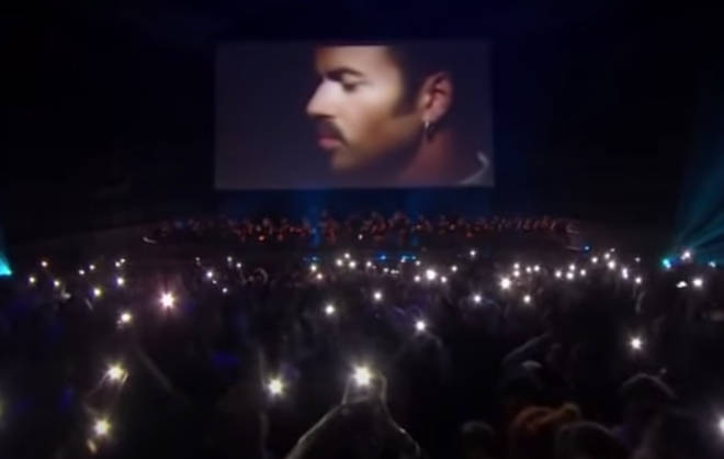 The night was infused with tributes and praise for George Michael's life, but no one was expecting the hauntingly beautiful moment George Michael himself would appear to perform on stage (pictured).