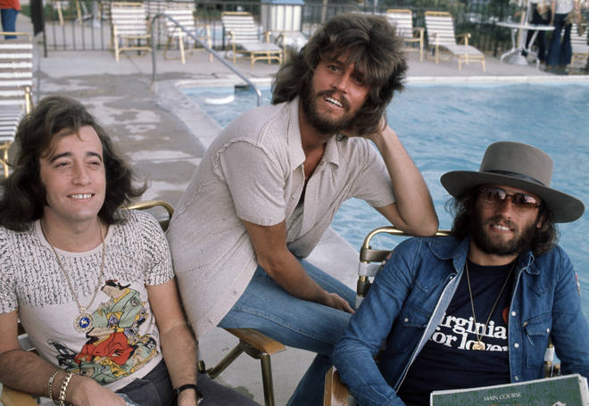 During their career, the Bee Gees scored 19 UK top 10 singles, including five number ones. Left to right: Robin, Barry and Maurice Gibb pictured in 1975.