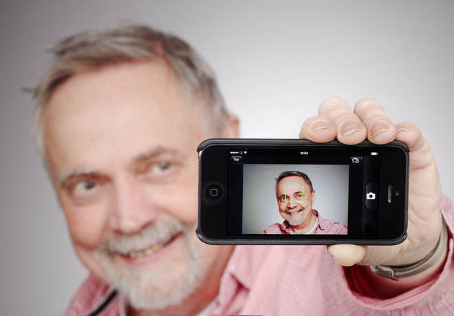 Man taking a selfie with his smartphone.