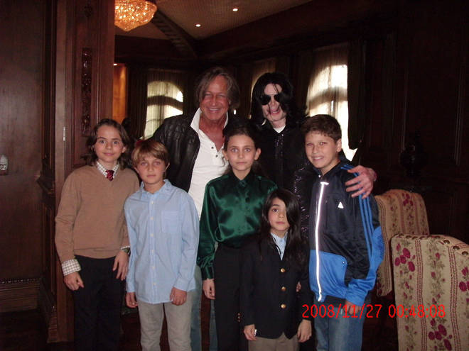 Paris Jackson (centre) poses with her father Michael Jackson (top right) and brothers Blanket (front) and Prince Michael (far left) at Neverland Ranch in 2008.