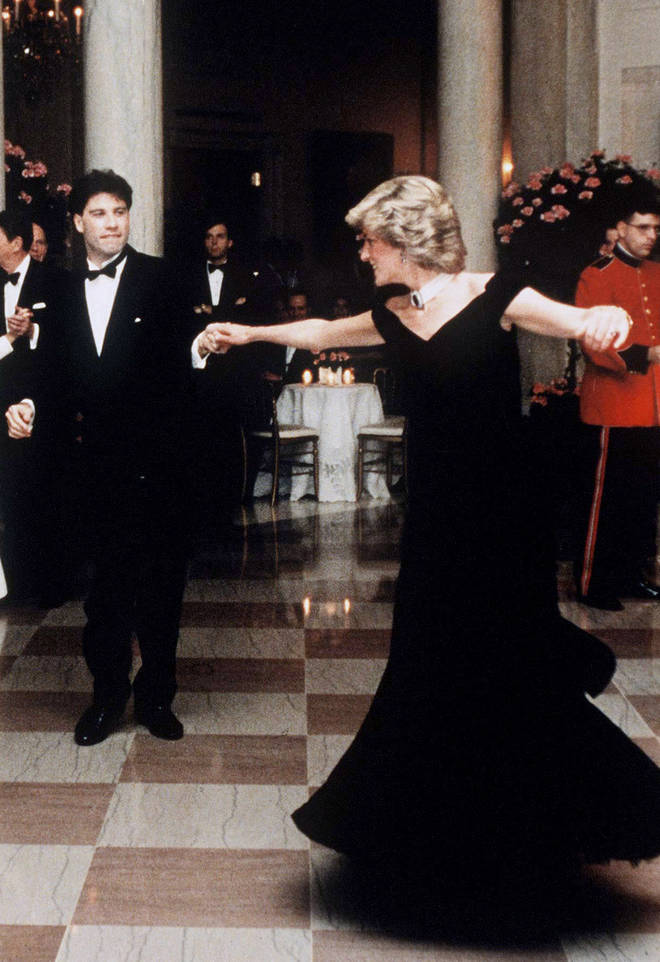 """""""I put my hand in the middle of her back, brought her hand down so that it wouldn't be so high and gave her the confidence that we would do just fine,"""" John Travolta later said of his dance with Princess Diana (pictured)."""