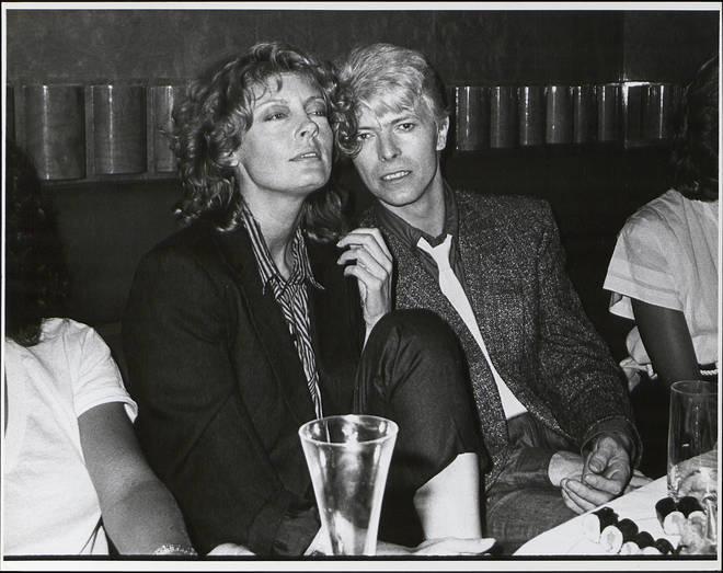 David Bowie at a party with actress Susan Sarandon, circa 1983.