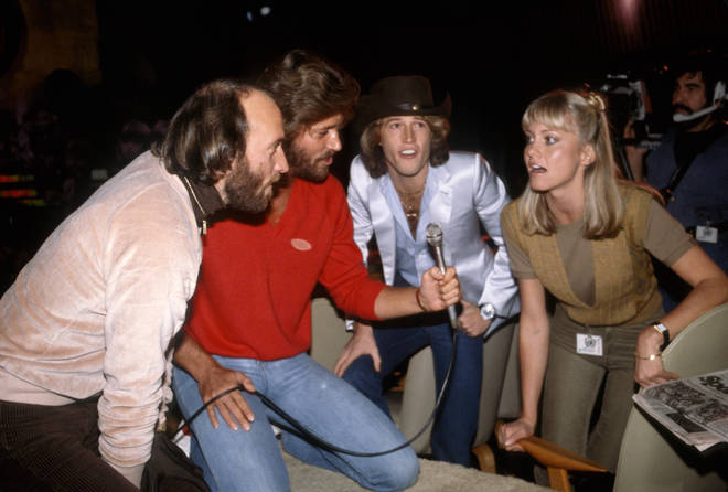 Bee Gee brothers (L to R) Maurice Gibb, Barry Gibb, Andy Gibb and Olivia Newton-John practising harmonies, circa 1980 in New York City.