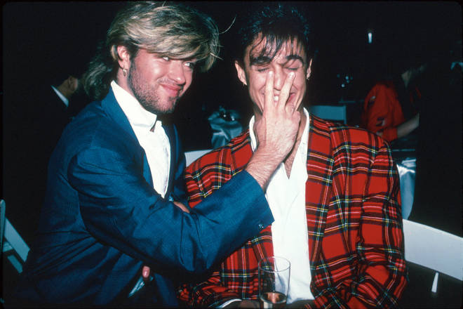 Wham!'s George Michael and Andrew Ridgeley backstage at a concert in Japan in 1985.
