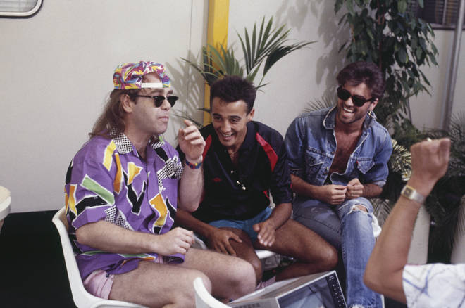 Andrew Ridgeley and George Michael (right) of Wham! with Elton John (left) backstage prior to performing at their farewell concert, entitled 'The Final' at Wembley Stadium in London on 28th June 1986.