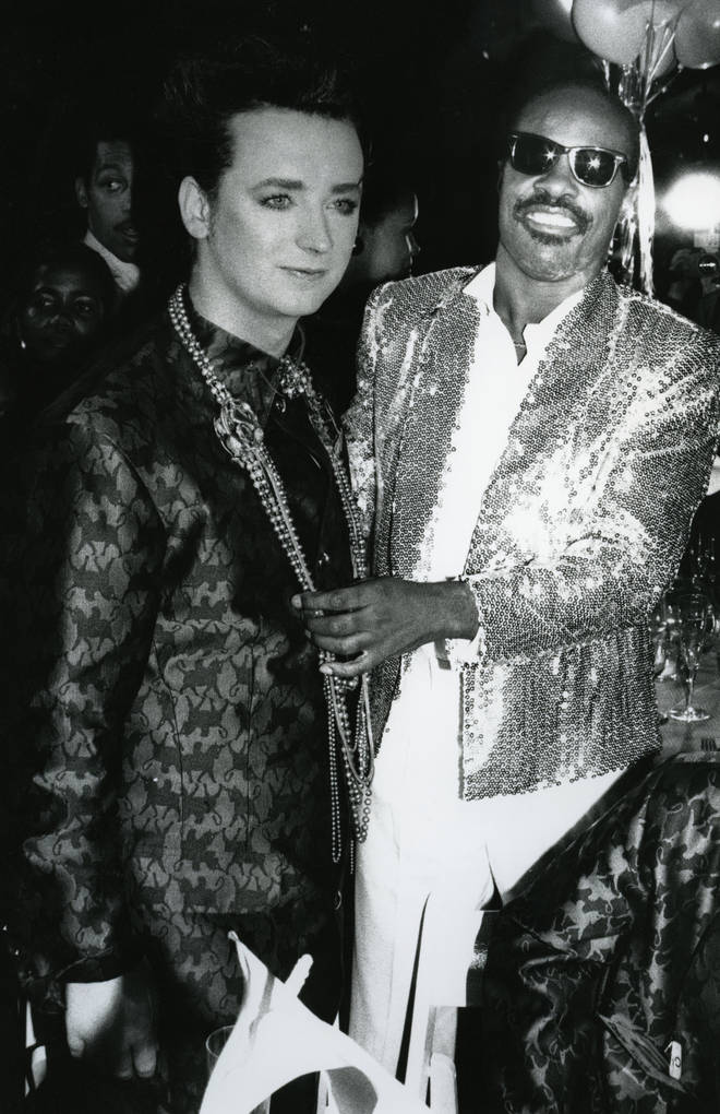 Boy George with Stevie Wonder during the taping of the television special 'Motown Returns to the Apollo,' Harlem, New York, May 4, 1985.
