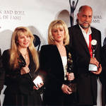Mick Fleetwood has insisted that Fleetwood Mac are 'still together'. Pictured left to right: John McVie, Stevie Nicks, Christine McVie, Mick Fleetwood and Lindsay Buckingham