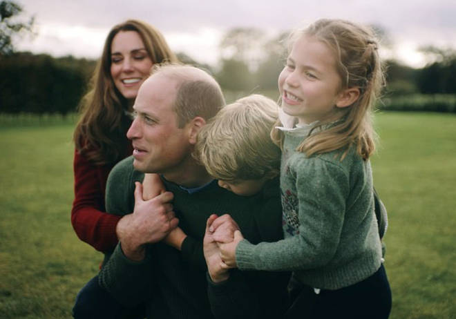 The video shows the Duke and Duchess of Cambridge playing with their children and roasting marshmallows in the garden their home Amner Hall in Norfolk.