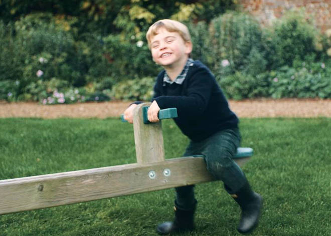 Prince Louis laughs as he plays on a seesaw with his sister Princess Charlotte, in the garden of the Duke and Duchess of Cambridge's Norfolk home, Anmer Hall.