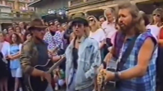 Bee Gees Robin (centre), Maurice (left) and Barry Gibb (right) busked in London's Covent Garden in 1993.