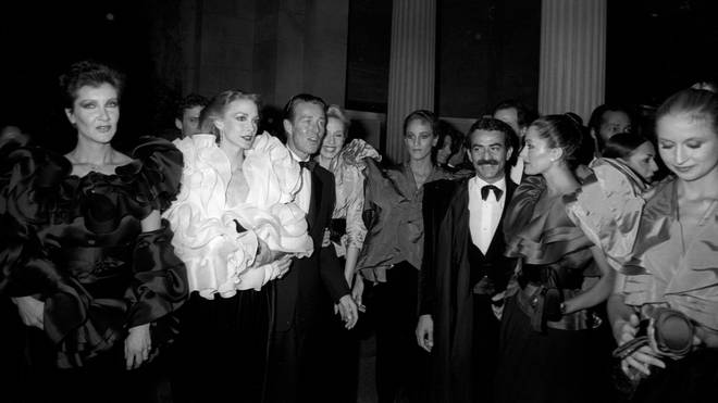 Halston and partner Victor Hugo pictured with models at the New York Met