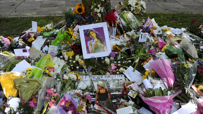 Flowers, pictures and messages are left near Amy Winehouse's home after her death