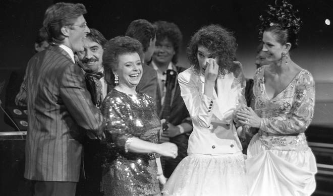 After the nail-biting ending, Celine Dion's manager René Angélil, who she would later marry, encouraged her to go up on stage to collect her prize and sing her winning song once more.