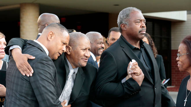 Clarence Franklin (centre) at his mother's funeral in 2018