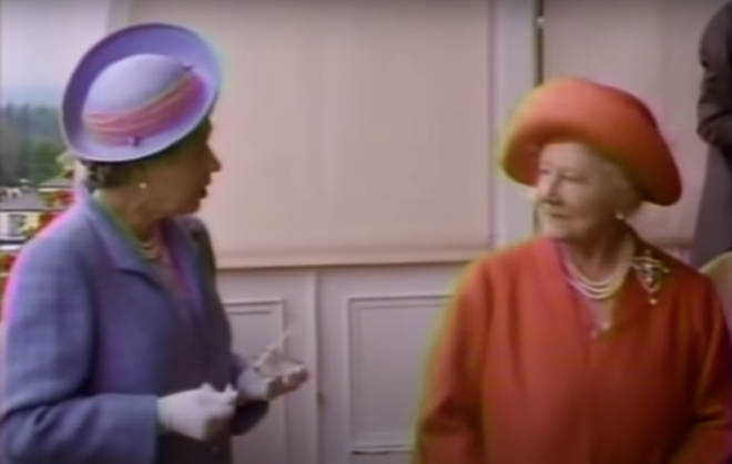 Elizabeth II was on the balcony with her mother at the Epsom Downs racecourse in 1991 as the pair watch the Queen's horse, Enharmonic, come fourth in the famous Epsom Derby.