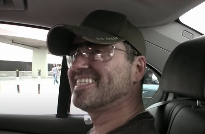 """""""Sorry, i&squot;d know him a mile away and that is not George Michael!"""" he says as the camera pans to a very real George Michael laughing in the back of the car."""