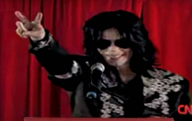 Introduced by presenter Dermot O'Leary, Michael Jackson then stepped up to the podium to the delight of screaming fans, his long dark hair and black aviator sunglasses obscuring his face.