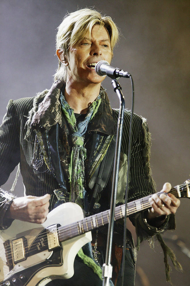 The singer released his 25th and final album Black Star on his 69th birthday and passed away just two days later, to the shock of fans all over the world. (Pictured on stage in 2004)