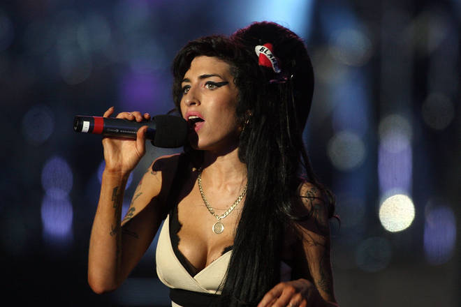 """""""The minute you go on stage, everything's OK. The minute you start singing,"""" Amy Winehouse said in the interview before her death in 2011. Pictured on stage in Hyde Park in 2008."""
