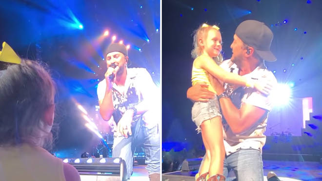 Luke Bryan makes a 7-year-old fan's dream come true with adorable on-stage duet - video